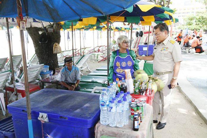 Deputy Mayor Vichien Pongpanit visits Pattaya beach vendors looking for anyone refusing to follow regulations on smoking and cleanliness.