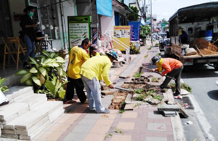 Pattaya engineers repair a damaged sidewalk on Thappraya Road following complaints.
