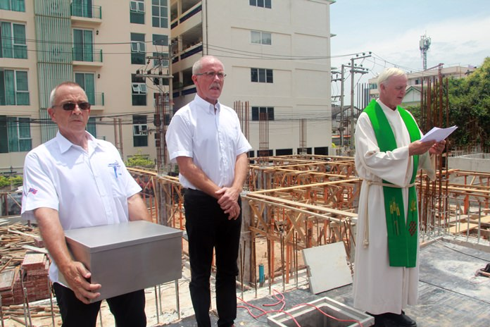 Pastors from the Norwegian Church Abroad perform the groundbreaking ceremony.