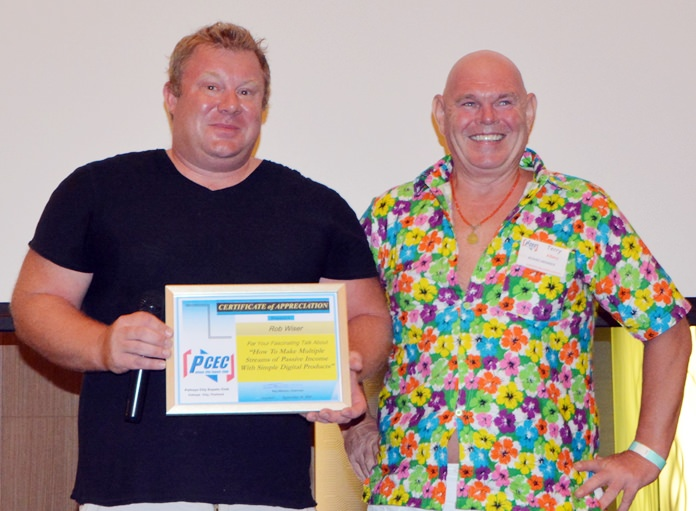 MC Terry Albery presents the PCEC's Certificate of Appreciation to Rob Wiser for his very informative and interesting talk on ways to earn passive income through internet marketing of digital products.