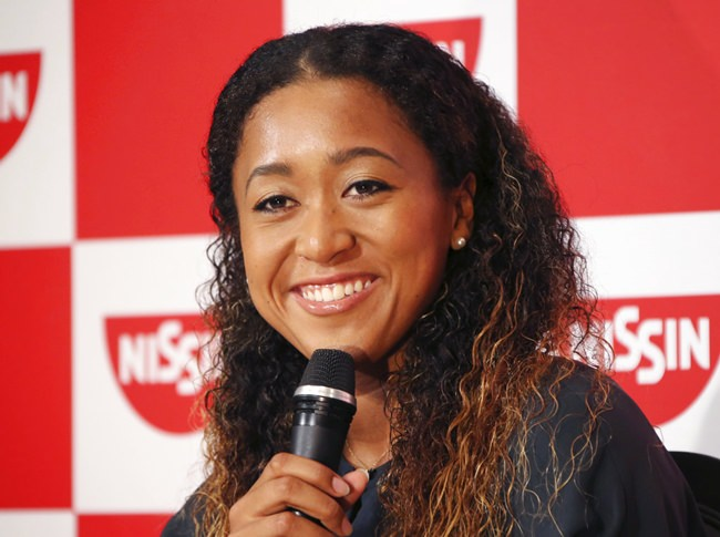 Naomi Osaka, the champion of U.S. Open women's singles, smiles during a press conference in Yokohama, Thursday, Sept. 13, 2018. Osaka defeated Serena Williams of the U.S. on Saturday, Sept. 8, to become the first Grand Slam singles champion from Japan. (AP Photo/Koji Sasahara)