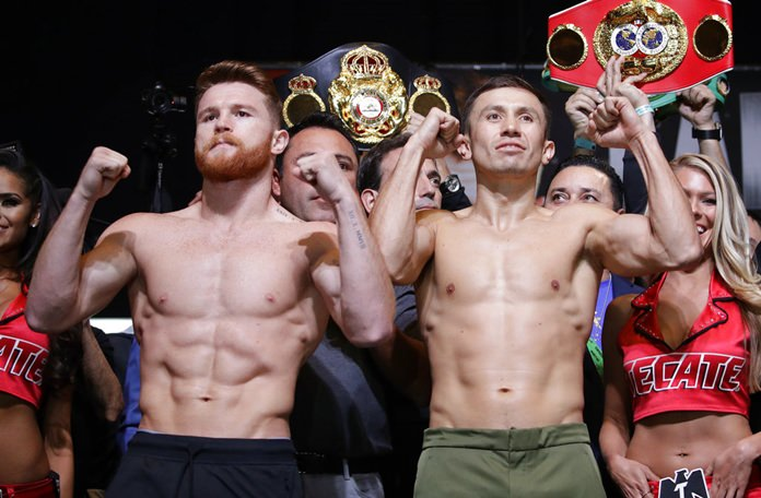 In this Sept. 15, 2017, file photo, Canelo Alvarez, left, and Gennady Golovkin pose during a weigh-in in Las Vegas. Golovkin's trainer says his fighter was insulted when Alvarez tested positive for a performance enhancing drug that caused their planned May middleweight title rematch to be postponed. (AP Photo/John Locher, File)