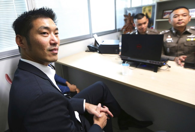 The leader of the political party named Future Forward Party, Thanathorn Juangroongruangkit arrives at the Technology Crime Suppression Division to hear police charges in Bangkok, Monday, Sept. 17. (AP Photo/Sakchai Lalit)