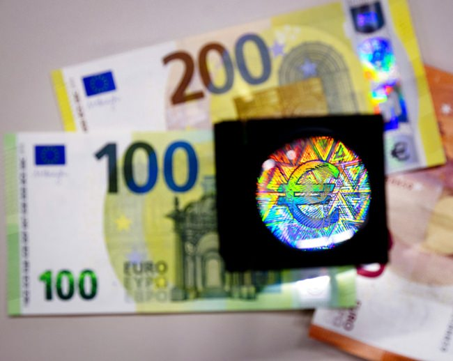 Large copies of the new 100 and 200 Euro notes with new and better security features are unveiled at the European Central Bank in Frankfurt, Germany, Monday, Sept. 17. (AP Photo/Michael Probst)