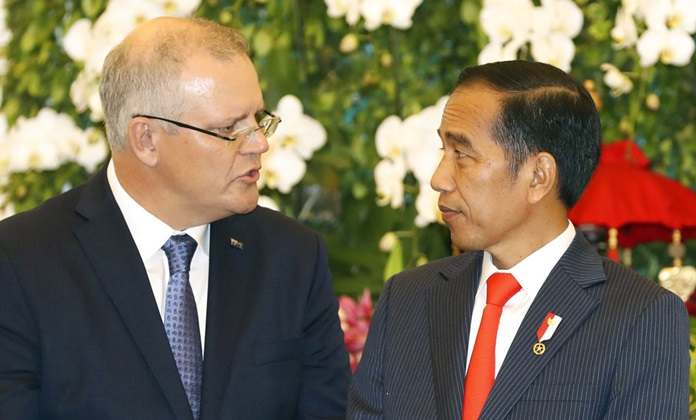 Australian Prime Minister Scott Morrison, left, talks to Indonesian President Joko Widodo, right, during a signing ceremony at the presidential palace in Bogor, West Java, Indonesia, Friday, Aug. 31, 2018. (AP Photo/Achmad Ibrahim)