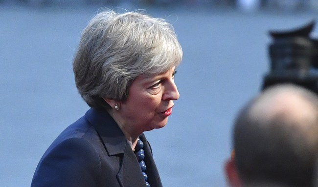 British Prime Minister Theresa May answers questions when arriving at the informal EU summit in Salzburg, Austria, Wednesday, Sept. 19. (AP Photo/Kerstin Joensson)