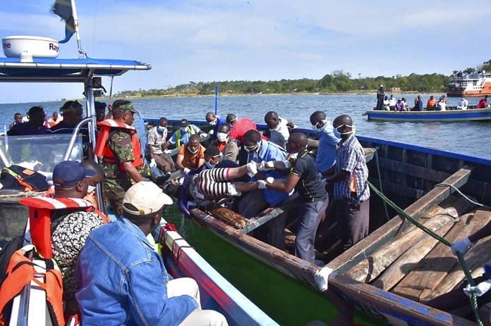 Rescuers retrieve a body from the water near Ukara Island in Lake Victoria, Tanzania Friday, Sept. 21. (AP Photo)