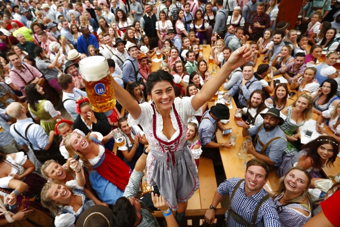 A young woman celebrates the opening of the 185th 'Oktoberfest' beer festival in Munich, Germany, Saturday, Sept. 22. (AP Photo/Matthias Schrader)