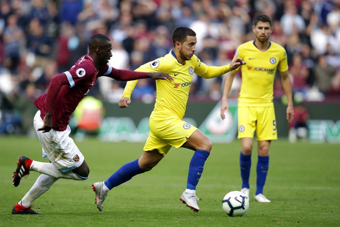 West Ham's Arthur Masuaku, left, chases Chelsea's Eden Hazard during the English Premier League soccer match between West Ham United and Chelsea at London Stadium in London, Sunday, Sept. 23. (AP Photo/Matt Dunham)