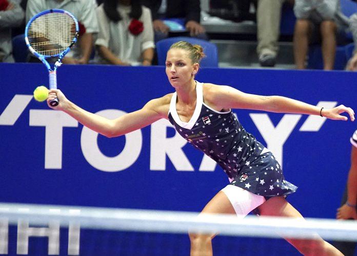 Karolina Pliskova of Czech Republic returns a shot against Naomi Osaka of Japan during the final match of the Pan Pacific Open women's tennis tournament in Tokyo Sunday, Sept. 23. (AP Photo/Eugene Hoshiko)