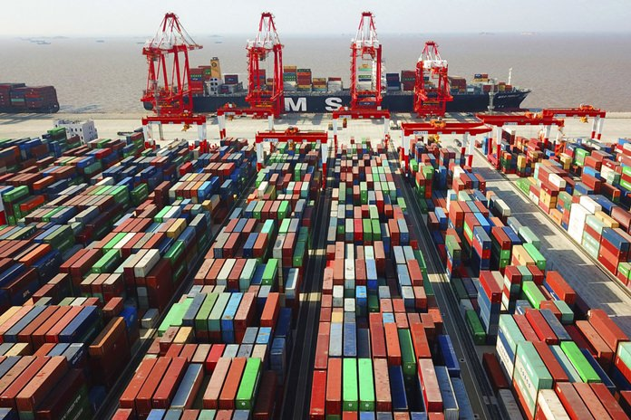 In this April 10, 2018, file photo, a cargo ship is docked at the Yangshan container port in Shanghai, China. (Chinatopix via AP)