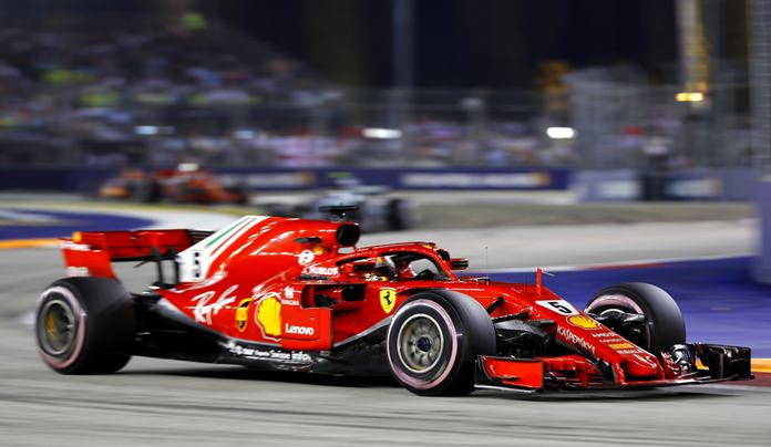 In this file photo dated Sunday, Sept. 16, 2018, Ferrari driver Sebastian Vettel of Germany steers his car during the Formula One Grand Prix of Singapore at Marina Bay Street Circuit in Singapore. (AP Photo/Vincent Thian)