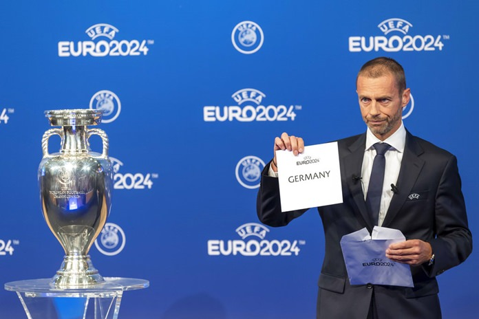 UEFA president Aleksander Ceferin, announces that Germany will stage the 2024 European Championships, during the Euro 2024 Host Announcement Ceremony, at the UEFA Executive Committee at the UEFA Headquarters, in Nyon, Switzerland, Thursday, September 27. (Martial Trezzini/Keystone via AP)