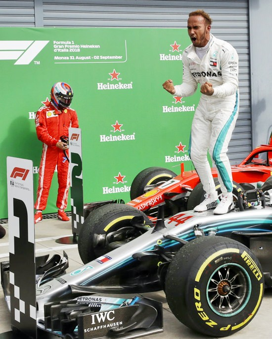 Mercedes driver Lewis Hamilton of Britain, right, celebrates after winning the Formula One Italy Grand Prix at the Monza racetrack, in Monza, Italy, Sunday, Sept. 2, 2018. (AP Photo/Luca Bruno)
