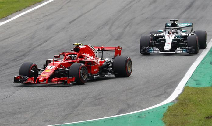 Ferrari driver Kimi Raikkonen of Finland front followed by Mercedes driver Lewis Hamilton of Britain steer their cars during the Formula One Italy Grand Prix at the Monza racetrack, in Monza, Italy, Sunday, Sept. 2, 2018. (AP Photo/Antonio Calanni)