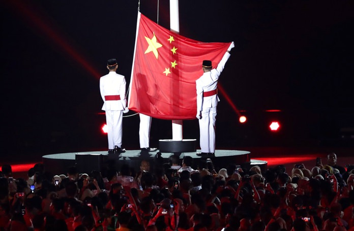 The Chinese flag is raised as the next host country during the closing ceremony for the 18th Asian Games in Jakarta, Indonesia, Sunday, Sept. 2, 2018. (AP Photo/Lee Jin-man)