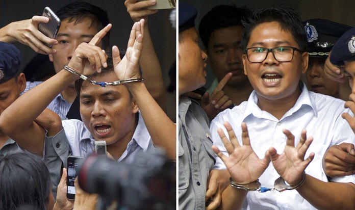 In this combination image made from two photos, Reuters journalists Kyaw Soe Oo, left, and Wa Lone, are handcuffed as they are escorted by police out of the court Monday, Sept. 3, 2018, in Yangon, Myanmar. (AP Photo/Thein Zaw)