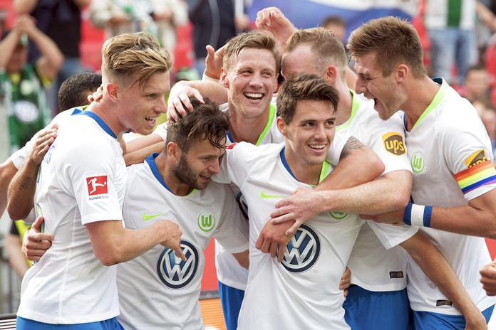 In this Saturday, Sept. 1, 2018 photo Wolfsburg's players celebrate their side's 3rd goal during the German Bundesliga soccer match between Bayer 04 Leverkusen and VfL Wolfsburg in Leverkusen, Germany. Wolfsburg is bucking expectations after starting the Bundesliga with two wins over highly rated Schalke and Bayer Leverkusen. (Federico Gambarini/dpa via AP)