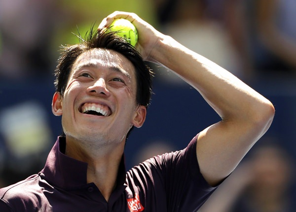 Kei Nishikori, of Japan, smiles after defeating Philipp Kohlschreiber, of Germany, during the fourth round of the U.S. Open tennis tournament, Monday, Sept. 3, 2018, in New York. (AP Photo/Kevin Hagen)