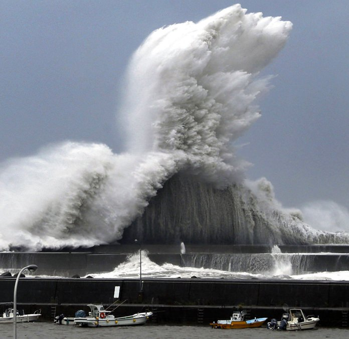 High waves hit breakwaters at a port of Aki, Kochi prefecture, Japan, Tuesday, Sept. 4, 2018. Powerful Typhoon Jebi is approaching Japan's Pacific coast and forecast to bring heavy rain and high winds to much of the country. (Ichiro Banno/Kyodo News via AP)