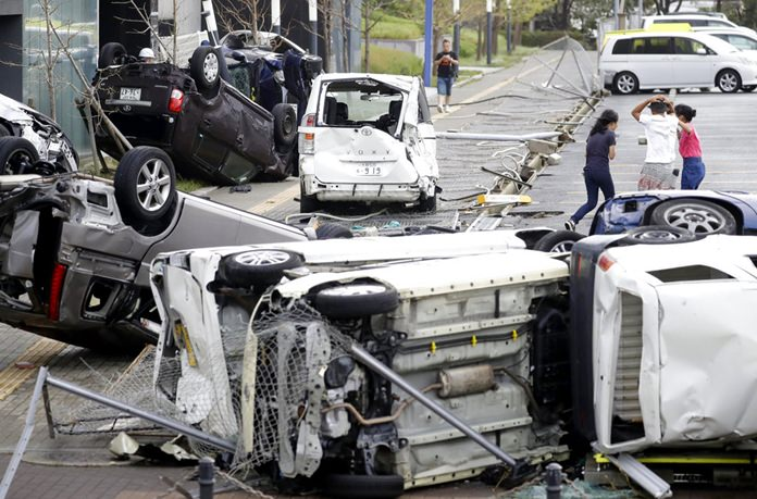 Overturned cars are seen on street following a powerful typhoon in Osaka, western Japan, Tuesday, Sept. 4, 2018. (Kota Endo/Kyodo News via AP)