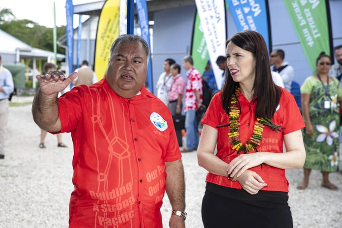 Nauru President Baron Waqa, left, talks with New Zealand Prime Minister Jacinda Ardern before the Pacific leaders gather for a photo opportunity during the Pacific Islands Forum in Nauru, Wednesday, Sept. 5, 2018. (Jason Oxenham/Pool Photo via AP)