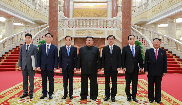 In this Wednesday, Sept. 5, 2018 photo provided on Thursday, Sept. 6, 2018 by South Korea Presidential Blue House via Yonhap News Agency, North Korean leader Kim Jong Un, center, poses for a photograph with members of South Korean delegation headed by National Security Director Chung Eui-yong, third from left, and Kim Yong Chol, a North Korean senior ruling party official and former intelligence chief, right, in Pyongyang, North Korea. (South Korea Presidential Blue House/Yonhap via AP)