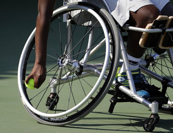 "Kgothatso ""KG"" Montjane maneuvers her wheelchair during a practice session for the wheelchair competition at the U.S. Open tennis tournament, Wednesday, Sept. 5, 2018, in New York. (AP Photo/Darron Cummings)"