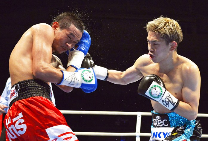 In this May 8, 2013, file photo, Japanese champion Kazuto Ioka, right, sends a right to Thai challenger Wisanu Kokietgym in the fourth round of their WBA light flyweight boxing title match in Osaka, western Japan. Ioka knocked out Wisanu in the ninth round to retain his title. Ioka is ending his brief retirement to make his U.S. debut against McWilliams Arroyo on Saturday, Sept. 8, 2018. He hopes the bout will lead to a title shot in his fourth weight class. (Kyodo News via AP, File)