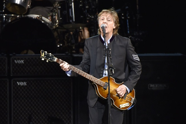 """In this July 26, 2017 file photo, Paul McCartney performs on the One on One Tour at the Hollywood Casino Amphitheatre in Tinley Park, Ill. Commuters with tickets to ride out of New York's Grand Central Station heard a special serenade on Friday evening, Sept. 7, 2018, with McCartney taking over a corner of the majestic hub for a concert. It was a stunt to promote a new album called """"Egypt Station."""" (Photo by Rob Grabowski/Invision/AP, File)"""