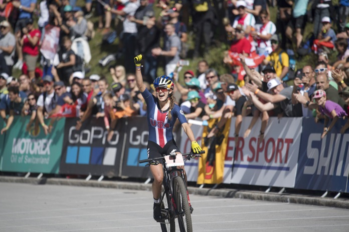Kate Courtney from the U.S wins the women's elite cross country olympic race at the UCI mountain bike world championships in Lenzerheide, Switzerland, Saturday, Sept. 8, 2018. The World Championships takes place from Sept. 5 till Sept. 9, 2018. (Gian Ehrenzeller/Keystone via AP)