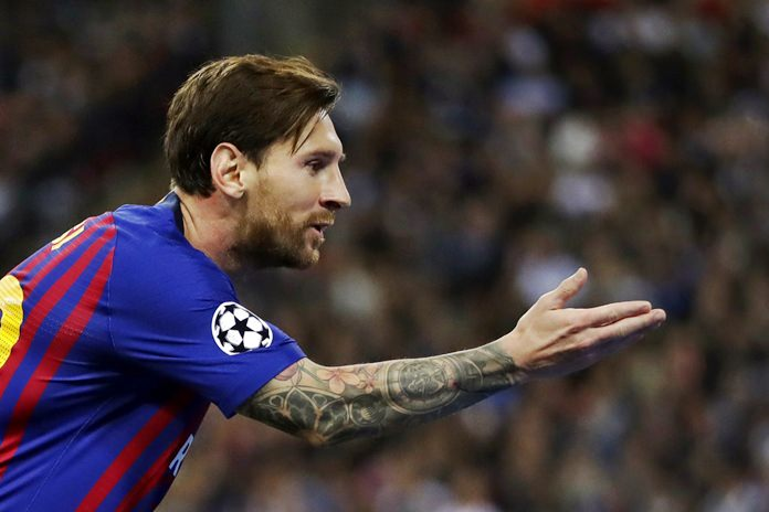 Barcelona forward Lionel Messi celebrates after scoring his side's third goal during the Champions League Group B soccer match between Tottenham Hotspur and Barcelona at Wembley Stadium in London, Wednesday, Oct. 3. (AP Photo/Kirsty Wigglesworth)