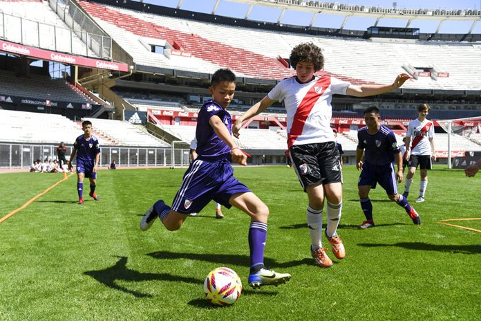 Young soccer Thai team Wild Boars play a friendly match against River Plate youth team at Monumental stadium in Buenos Aires, Argentina, Sunday, Oct. 7. (Eitan Abramovich/Pool via AP)