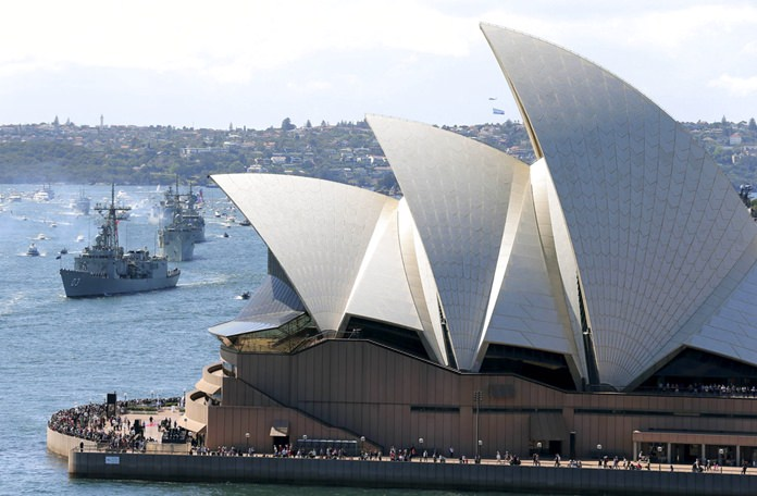 In this Oct. 4, 2013, file photo, the Opera House is seen as Australian warships enter the harbour in Sydney, Australia, during the International Fleet review. (AP Photo/Rob Griffith)