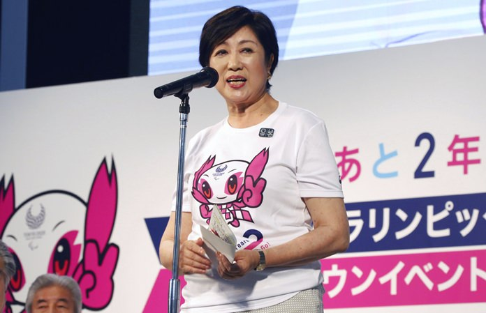 """In this Aug. 25, 2018, file photo, Governor of Tokyo Yuriko Koike speaks during the countdown event of """" Two Years to Go to the Tokyo 2020 Paralympic Games"""" in Tokyo. (AP Photo/Koji Sasahara)"""