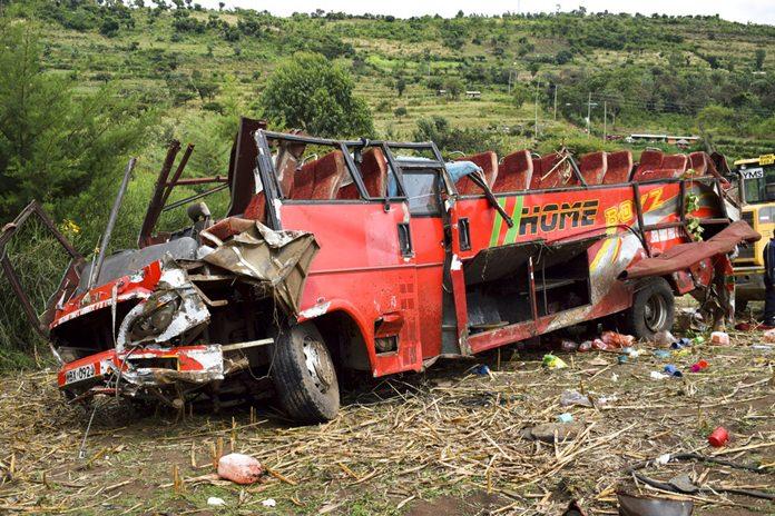 The wrecked bus is seen at the scene of the crash near Kericho in western Kenya Wednesday, Oct. 10. (AP Photo/Washington Sigu)