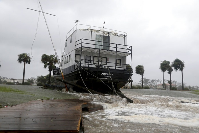 The Oceanis is grounded by a tidal surge, Wednesday, Oct. 10, in Port St. Joe, Florida, USA. (Douglas R. Clifford/Tampa Bay Times via AP)