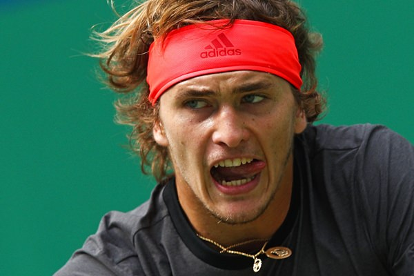 Alexander Zverev of Germany watches his shot as he plays against Nikoloz Basilashvili of Georgia during their men's singles match in the Shanghai Masters tennis tournament at Qizhong Forest Sports City Tennis Center in Shanghai, China, Wednesday, Oct. 10. (AP Photo/Andy Wong)
