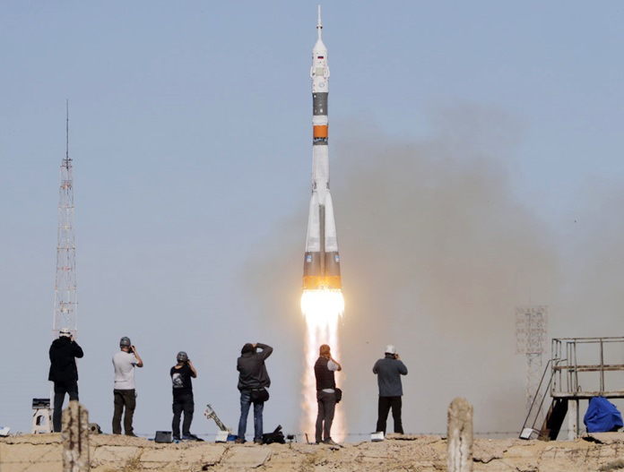 The Soyuz-FG rocket booster with Soyuz MS-10 space ship carrying a new crew to the International Space Station, ISS, blasts off at the Russian leased Baikonur cosmodrome, Kazakhstan, Thursday, Oct. 11. (AP Photo/Dmitri Lovetsky)