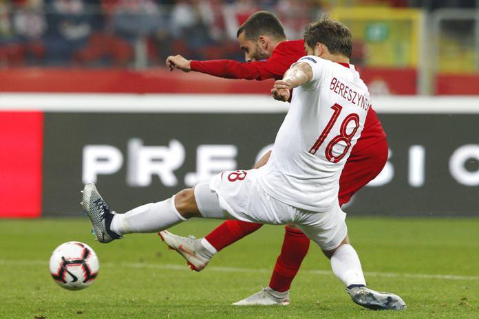 Portugal's Rafa Silva, rear, shoots as Poland's Bartosz Bereszynski tries to block during the UEFA Nations League soccer match between Poland and Portugal at the Silesian Stadium Chorzow, Poland, Thursday Oct. 11. (AP Photo/Czarek Sokolowski)