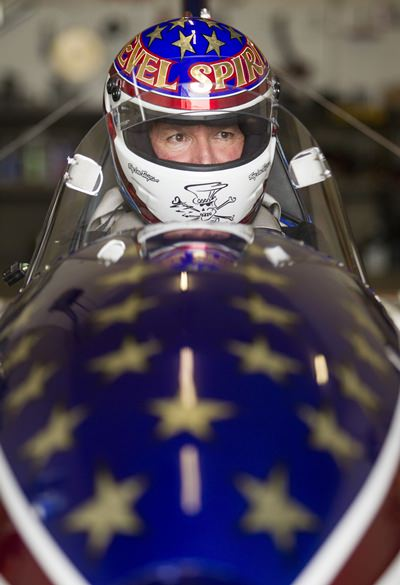 """In this Sept. 1, 2016, file photo, stuntman Eddie Braun sits in the cockpit of the """"Evel Spirit"""", a steam-powered rocket, at the team's shop in Twin Falls, Idaho. (Drew Nash/The Times-News via AP)"""