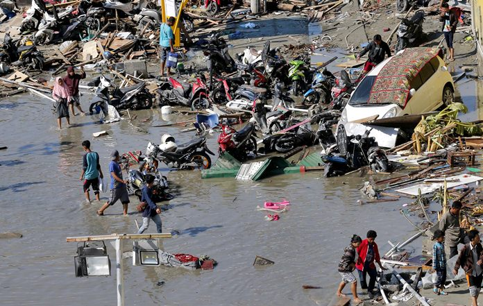 The magnitude 7.5 earthquake struck the Indonesian island of Sulawesi at dusk Friday, Sept. 28, and spawned a tsunami said to have been as high as 6 meters (20 feet) in places that left heart-wrenching scenes of destruction and human suffering. The toll of more than 1,200 dead is largely from the city of Palu and is expected to rise as areas cut off by the damage are reached. The regencies of Donggala, Sigi and Parigi Moutong - with a combined population of 1.2 million - have yet to be fully assessed. (AP Photo/Tatan Syuflana)