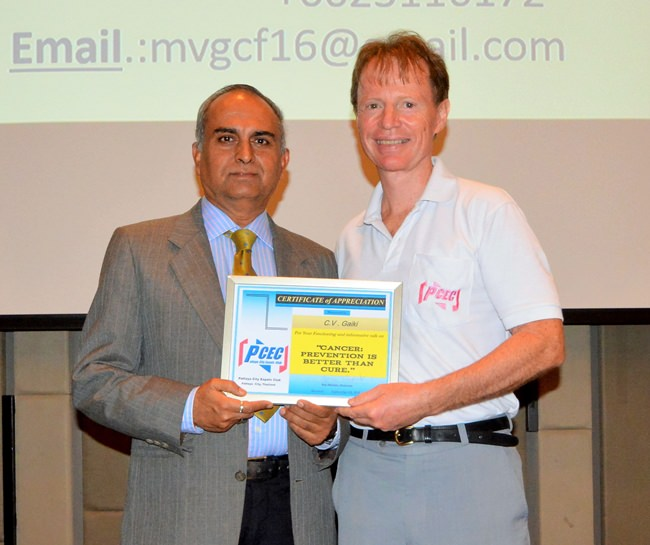 Member Ren Lexander presents C.V. Gaiki with the PCEC's Certificate of Appreciation for his interesting talk.