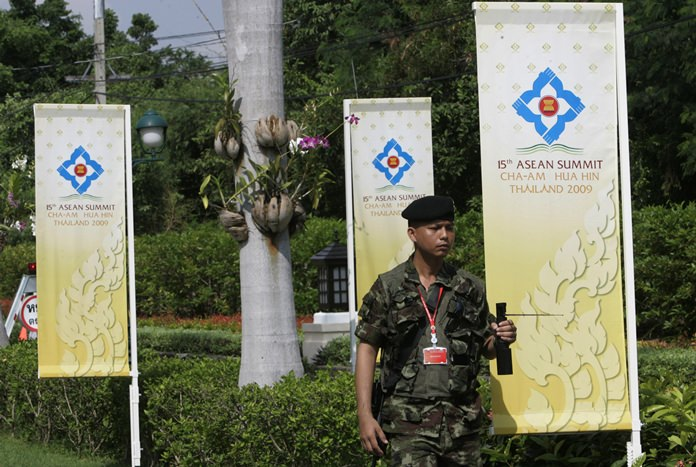 In this Thursday, Oct. 22, 2009, file photo, a soldier patrols with a mobile explosive detector GT 200 at a hotel in Cha-Am, a resort town in southern Thailand. (AP Photo/Sakchai Lalit, File)