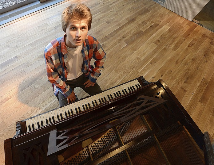 Tomasz Ritter, the Polish pianist who won the world's 1st Frederic Chopin competition on pianos from the romantic era, poses for a photo in Warsaw, Poland, Friday, Sept. 21. (AP Photo/Czarek Sokolowski)