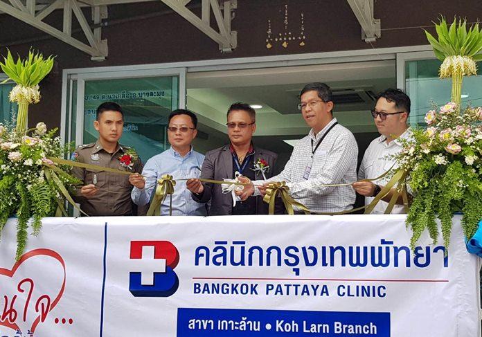 Executives cut the ceremonial ribbon to open Bangkok Hospital Pattaya's new clinic on Koh Larn.