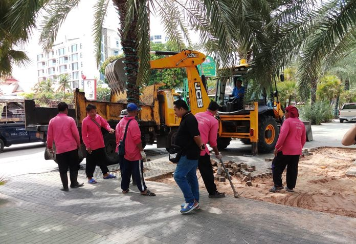 Pattaya is now demolishing parts of the Beach Road promenade to let storm runoff drain onto the beach.