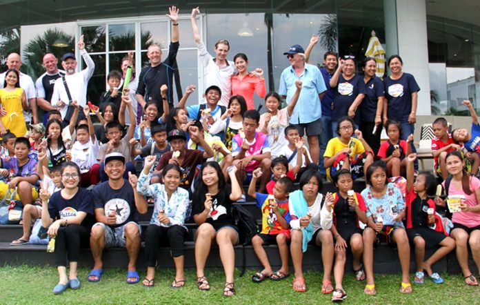 Orphans from the St. Camillus Foundation of Thailand pose with staff and volunteers at Ocean Marina Yacht Club near Pattaya during the children's sailing day, Saturday, September 29.