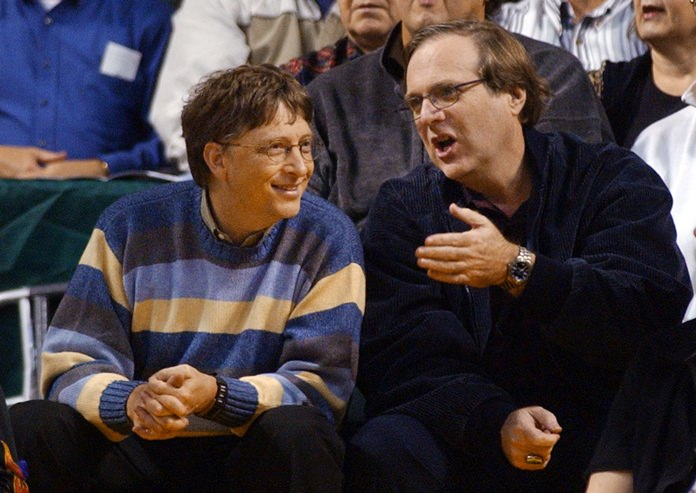 Microsoft Chairman Bill Gates, left, chats with Portland Trail Blazers owner and former business partner Paul Allen during a game between the Trail Blazers and Seattle SuperSonics in Seattle.  (AP Photo/Elaine Thompson, File)