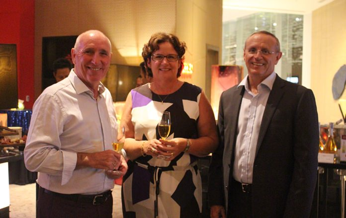 Helen Trabut is flanked by Michael Scollins (left) and the ever so friendly GM Jean-Pierre Trabut (right).
